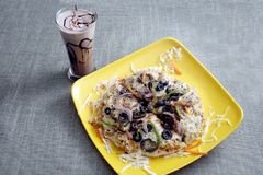 Italian Pan Pizza served with Cold coffee. Fresh pan pizza with olives & cold chocolate coffee beverage royalty free stock photos