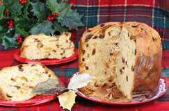 Italian Panettone Cake, whole and sliced. Stock Image