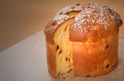 Italian Panettone Christmas Bread. With powdered sugar with a slice cut out Stock Image