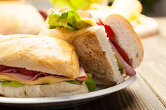 Italian panini sandwich with ham, cheese and tomato. Panini sandwich with ham, cheese and tomato Royalty Free Stock Photography