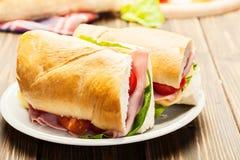 Italian panini sandwich with ham, cheese and tomato. Panini sandwich with ham, cheese and tomato Stock Photo