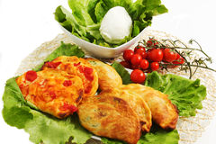 Italian panzerotti. With on a white background with tomatoes and mozzarella Stock Images