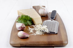Italian parmesan cheese with garlic, fresh coriander and grater Royalty Free Stock Photo