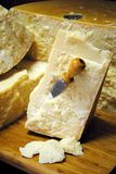 Italian parmesan cheese wooden cutti. Italian parmesan cheese with knife on wooden cutting board Stock Photography