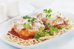 Italian parmesan chicken with spaghetti pasta. Italian parmesan chicken with melted cheese and tomato sauce served over spaghetti pasta Stock Image