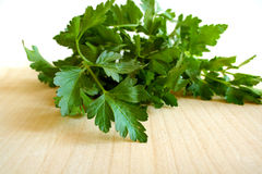 Italian parsley. A bunch of italian parsley on a cutting board Stock Photography