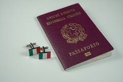 Italian passport with cufflinks with Italian flag green, white, red Stock Image