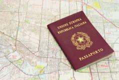 Passport on map. Italian passport on a map Stock Photo