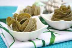 Italian pasta. Some fresh italian pasta made with spinach royalty free stock images