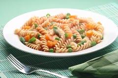 Italian pasta. Fresh Italian pasta garnished with vegetables Royalty Free Stock Photography