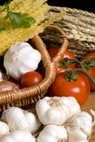 Italian Pasta. Fresh tomatoes, garlic, onions and mushrooms await preparation for great Italian pasta Stock Image