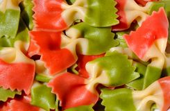 Italian pasta. With the Italian flag colors : red, white and green . Detail of butterfly colored pasta Stock Photography