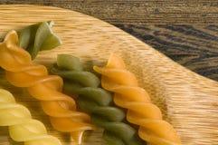 Italian pasta. Colourful italian pasta on the wood Royalty Free Stock Image