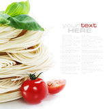 Italian Pasta. With tomatoes and basil on a white background with sample text Royalty Free Stock Photography