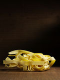 Italian pasta. Tagliatelle on wood table royalty free stock photos