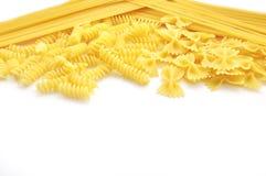 Italian pasta. Closeup of  italian pasta farfalle spaghetti with text area  isolated on white Royalty Free Stock Photos