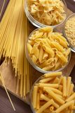 Italian pasta. Bowl with different kind of pasta, farfale, mezze penne rigate and spaghetti Royalty Free Stock Images