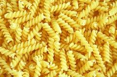 Italian pasta. Uncooked spiral Italian pasta background stock photo