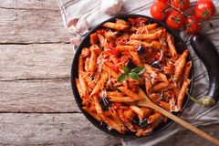 Italian Pasta alla Norma close-up and ingredients. horizontal to Royalty Free Stock Image