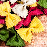 Italian Pasta as Textured Background close up. Raw Bow tie Colou Royalty Free Stock Photography