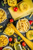Italian pasta assortment. Italian food concept, various raw pasta assortment - spaghetti, lasagna, fusilli, tagliatelle, penne, tortellini, ravioli, with stock images