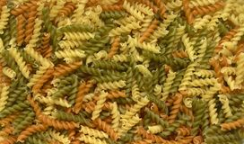 Italian pasta background. Full frame italian pasta background with lots of Radiatori noodles Stock Image