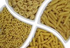 Italian pasta background. Full frame italian pasta background with lots of Radiatori noodles Royalty Free Stock Images