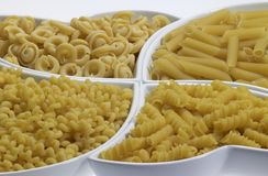 Italian pasta background. Full frame italian pasta background with lots of Radiatori noodles Royalty Free Stock Image