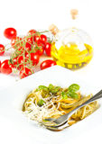 Italian pasta with basil,oil,tomatoes Stock Images