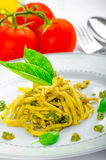 Italian pasta with basil pesto, late harvest wine Stock Photo