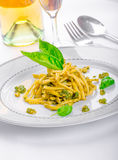 Italian pasta with basil pesto, late harvest wine Royalty Free Stock Photos