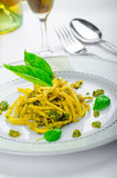 Italian pasta with basil pesto, late harvest wine Stock Photography