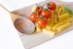 Italian pasta basil and tomato Royalty Free Stock Photo