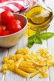 Italian pasta with basil, tomatoes and olive oil Stock Photo