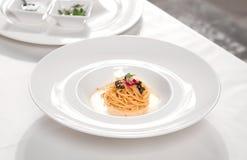 Italian pasta with black caviar and cream stock images