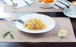 Italian pasta bolognese on a plate. Italian pasta bolognese with bacon on a plate Royalty Free Stock Photo