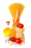 Italian pasta, a bottle of oil, tomatoes and spices Royalty Free Stock Photo