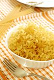 italian pasta in bowl on checkered tablecloth Stock Photos