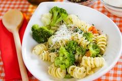 Italian pasta with broccoli. Delicious italian pasta with brocolli in white bowl Stock Images