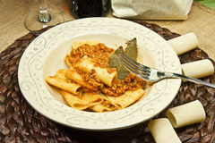 Italian pasta called `Paccheri` with meat souce. Italian culture Royalty Free Stock Photo