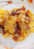 Italian pasta carbonara. Pappardell with pancetta bacon, egg and cheese sauce Stock Images