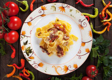 Italian pasta carbonara. Pappardelle noodles with pancetta, egg and cheese sauce Stock Photos