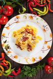Italian pasta carbonara. Pappardelle with pancetta bacon, egg and cheese sauce Royalty Free Stock Image
