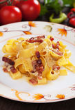 Italian pasta carbonara. Pappardelle with pancetta bacon, egg and cheese sauce Royalty Free Stock Images