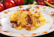 Italian pasta carbonara. Pappardelle with pancetta bacon in egg and cheese sauce Stock Photos