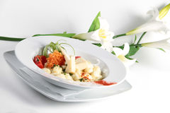 Italian pasta with cheese and flowers in the backg Stock Photo