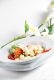 Italian pasta with cheese and flowers in the backg Royalty Free Stock Photo