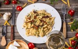 Italian pasta. With cheese sauce Stock Photos
