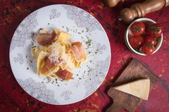 Italian pasta with prosciutto Royalty Free Stock Photography