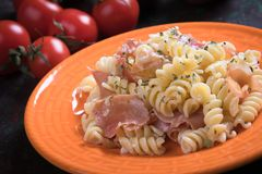 Italian pasta with prosciutto Stock Photos